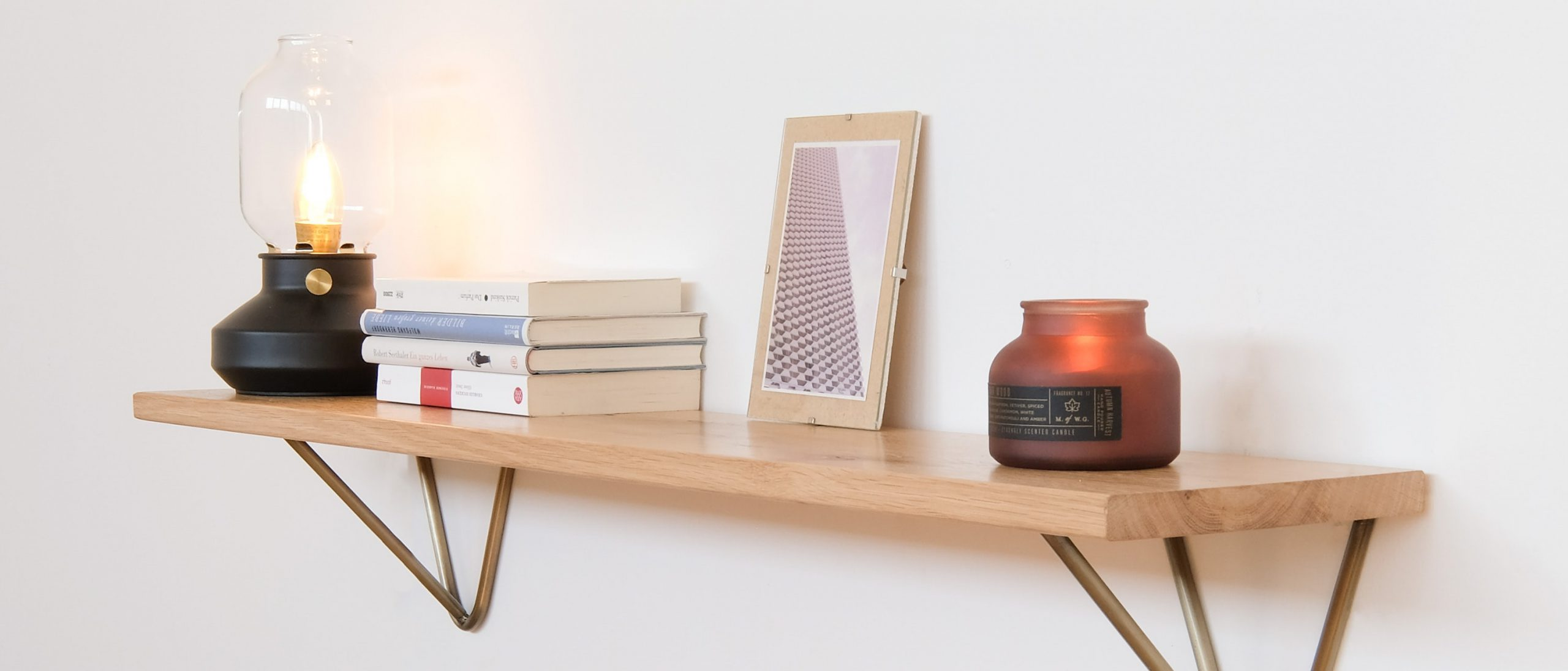 Single Floating Shelf containing candles and books